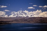 Bolivian Andes peak Mount Nevado Illampu and Lake Titicaca, view from Isla del Sol