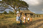 Farm laborer with his family in front of their house in rural Rivas department, west of Lake Nicaragua