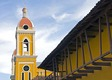 Colonial Granada architecture, the Cathedral bell tower and Hotel La Gran Francia facade