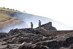 Masaya active shallow shield volcano, National Park visitors on overlook of smoking crater