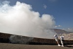 Masaya active shallow shield volcano, National Park visitors on overlook of smoking crater