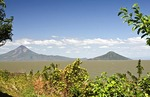 Momotombo active volcano with its smaller neighbor Momotombito on Lake Managua