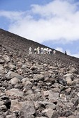 Cerro Negro Volcano with tourists climbing to crater at top of mountain