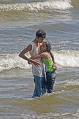 Teen couple at Lake Nicaragua beach at San Jorge