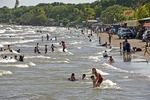 Lake Nicaragua beach at San Jorge with children swimming on weekend