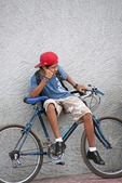 Granada teenager resting on his bicycle
