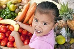 Curious Nicaraguan girl in fruit market in Catarina