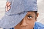 Granada, young boy wearing baseball cap