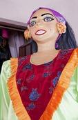 Nicaraguan traditional festival dance mask of tall woman at Masaya market