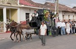 Granada, horse-drawn hearse leading funeral procession