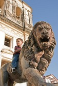 Leon Cathedral, Spanish colonial architecture, with Nicaraguan boy on lion statue flanking entrance