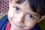 Nicaraguan boy in Masaya with big bright eyes