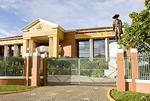 Managua's La Casa de Los Pueblos government house with statue of Sandino