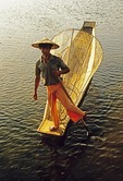 Inle Lake, Intha leg rower with fishing net in boat in late afternoon light