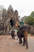 Angkor Thom south gate with tourists on elephants