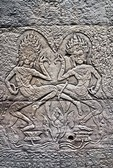 Angkor's Banteay Kdei temple ruins, bas relief carving in stone of pair of apsara dancers (celestial nymphs)