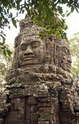 Angkor's Banteay Kdei temple ruins stone face tower of Avalokiteshvara