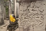 Angkor's Bayon Temple, bas relief stone carvings of apsaras or celestial nymphs, at Angkor Thom