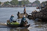 Tonle Sap lake with floating village, women boating to market