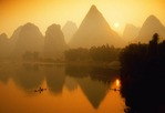 Yangshuo sunrise on Li River (Lijiang) with silhouetted cormorant fishermen on bamboo rafts near Guilin