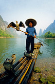Li River cormorant fisherman on bamboo raft near Xingping (Guilin area)