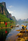 Li River cormorant fishermen on bamboo rafts near Xingping (Guilin area)