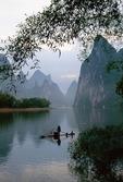 Li River with cormorant fishermen on bamboo raft near Xingping (Guilin area)