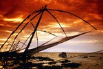 Cantilevered Chinese fishing nets at dusk along tip of Fort Cochin on Malabar coast of Arabian Sea at Cochin (Kochi) in Kerala