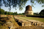Sarnath monastery ruins, with Dhamekh Stupa, site of first sermon by the Buddha