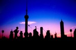 Shanghai Bund at dawn with Pudong skyline including Orient Pearl TV Tower, jogger, and kite flying