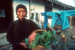 Portrait of elderly Chinese farm woman at Hua Yang village of suburban Shanghai