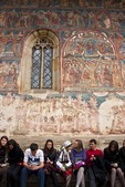 Young Romanians at Humor Painted Monastery of Bucovina decorated with 15th &amp; 16th century frescoes, masterpieces of Byzantine art