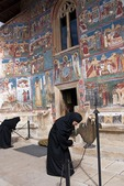Romanian nuns at Voronet Painted Monastery of Bucovina decorated with 15th & 16th century frescoes; masterpieces of Byzantine art