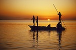 Fly fishing from flats boat near Islamorada in Florida Keys at sunset.