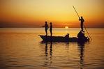 Fly fishing from flatboat near Islamorada in Florida Keys at sunset