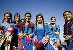 Turkmen school girls in traditional costume for public performance