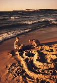 Children building sand castle on Lake Michigan beach at Sleeping Bear Dunes National Lakeshore