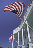 Grand Hotel on Mackinac Island with American flags on geranium lined porch 