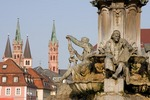 Wurzburg's Franconia Fountain and steeples near Residenz palace