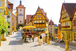 Rothenburg ob der Tauber's Ploenlein (Little Square) with Siebers Town Tower and town gate with clock on upper street and Kobolzeller Gate on lower
