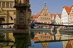 Rothenburg ob der Tauber's Ratstrinkstube (City Councilor's Tavern) reflected in fountain in Markt Square