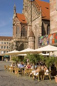 Nuremberg's Hauptmarkt, main market square, with outdoor cafe next to Frauenkirche (Church of Our Lady)