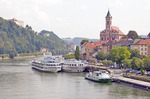 Danube River cruise ships at Passau with St Paul Church above
