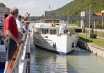 Danube River cruise ships in Jochenstein Lock and Power Station near Austrian border