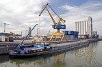 Main-Danube Canal loading dock with commercial barge in port