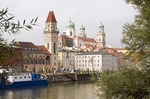 Danube River water front of Passau with Town Hall clock tower and St Stephan Cathedral