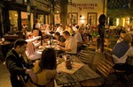 Rudesheim restaurant with diners in courtyard in evening on Drosselgasse Street