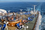 Cruise ship Diamond Princess at sea off coast of Mexico with passengers on aft deck in hot tub