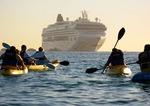 Sea kayakers and cruise ship at Land's End, Cabo San Lucas, Baja California
