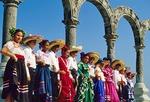 Puerto Vallarta children in traditional folkloric dance costumes under Los Arcos on El Malecon waterfront